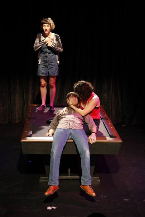 Photo by Robert Schulz.  All you need to produce this play is three actors, a pool table, and cue stick